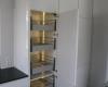 meble kuchenne biały wysoki połysk szuflady wewnętrzne
